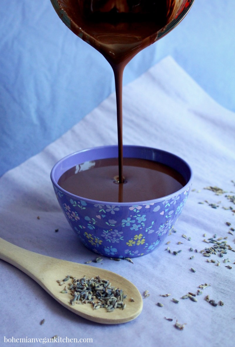 Be your own Willy Wonka and make this HEAVENLY vegan chocolate fondue, which is infused with healing lavender. Great for stress relief, anxiety, or just for kicks. This fondue is 100% vegan, and naturally gluten-free, nut-free, and soy-free. #veganchocolatefondue #veganchocolatefonduerecipe #veganchocolatefonduedairyfree #chocolatefonduerecipe #lavenderchocolate #bohemianvegankitchen