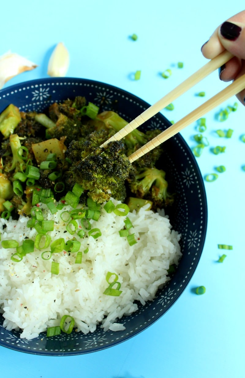 picture of picking up broccoli with chopsticks