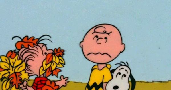 picture of Charlie Brown and Linus with leaves in his mouth.