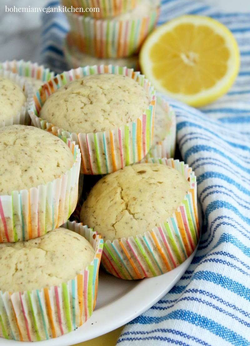 When life gives you lemons, forget making lemonade and make vegan lemon poppy seed muffins instead! Bursting with lemon-y flavor + packed with delicious poppy seeds, these muffins are the perfect breakfast muffin or on-the-go snack. Can easily be made gluten-free with a simple switch of flour. #veganlemonpoppyseedmuffins #veganlemonmuffins #veganlemonmuffinshealthy #veganlemonmuffinsdairyfree #veganlemonmuffinsglutenfree #veganlemonmuffinsrecipe #bohemianvegankitchen