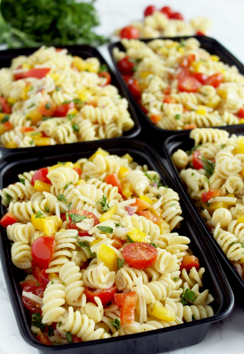 Be prepared for the week ahead with this simple + flavorful vegan pasta salad! Easy to pull together, this pasta salad can be made from start to finish in 20 minutes, leaving you more time to relax before you start your workweek. #veganpastasalad #veganpastasaladrecipes #veganpastasaladitalian #veganpastasaladeasy #bohemianvegankitchen