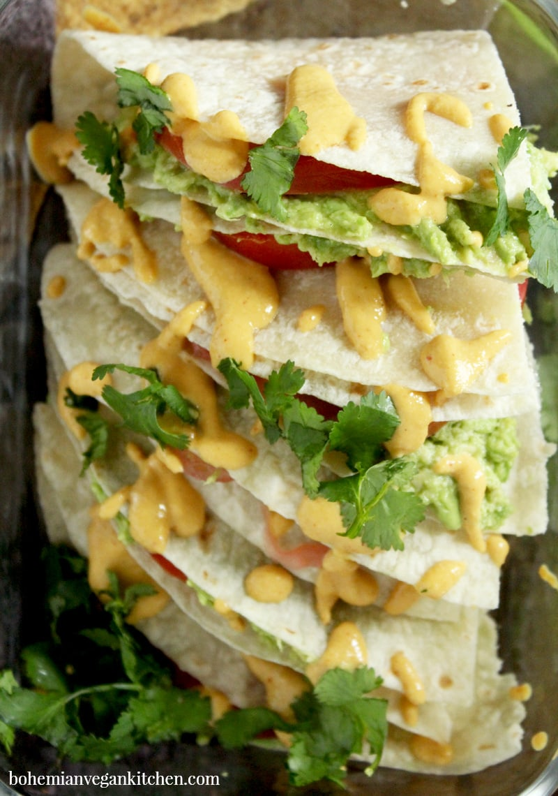 """This lunch is so easy, it will have you saying """"Yo quiero avocado quesadillas"""" faster than a talking chihuahua! A snap to pull together, plus totally customizable, you can have this lunch ready to go in only a few short minutes. Perfect for weekday lunches or a lazy dinner. #avocadoquesadilla #avocadoquesadillarecipes #avocadoquesadillavegan #avocadoquesadillacheese #avocadoquesadillahealthy #bohemianvegankitchen"""