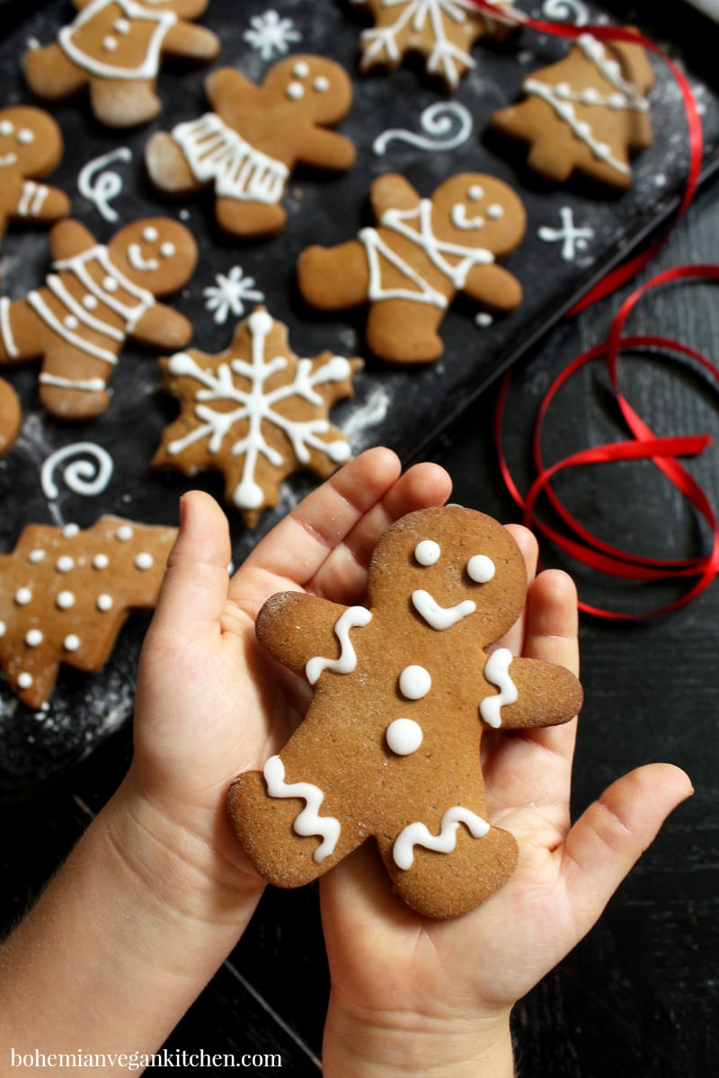 Get your kids in the kitchen with these classic vegan gingerbread cookies! Easy to make, these cookies are dairy-free, egg-free, nut-free, and soy-free. It's the perfect way to celebrate the holiday season! #vegangingerbread #vegangingerbreadcookies #vegangingerbreadmen #vegangingerbreadcookieseasy #veganchristmasrecipes #veganchristmascookies #bohemianvegankitchen
