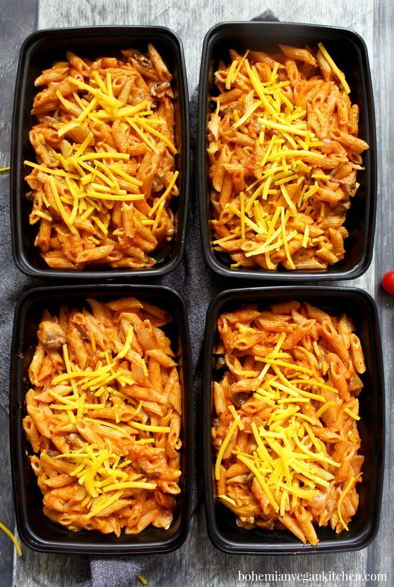 picture of four lunch Tupperware full of vegan chef boyardee