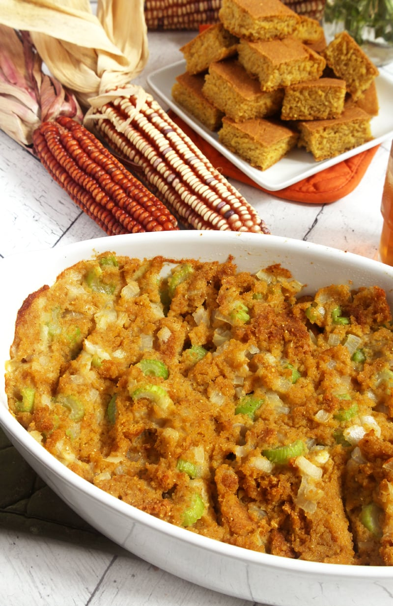Need a delicious vegan and gluten-free dish for Thanksgiving dinner? Try this simple vegan cornbread stuffing, which is naturally gluten-free AND refined sugar-free! Easy to pull together, this cornbread stuffing is so good, no one will even know it's vegan. #vegancornbreadstuffing #vegancornbreaddressing #vegancornbreadstuffingrecipe #veganthanksgiving #veganthanksgivingsides #veganchristmasrecipes #bohemianvegankitchen