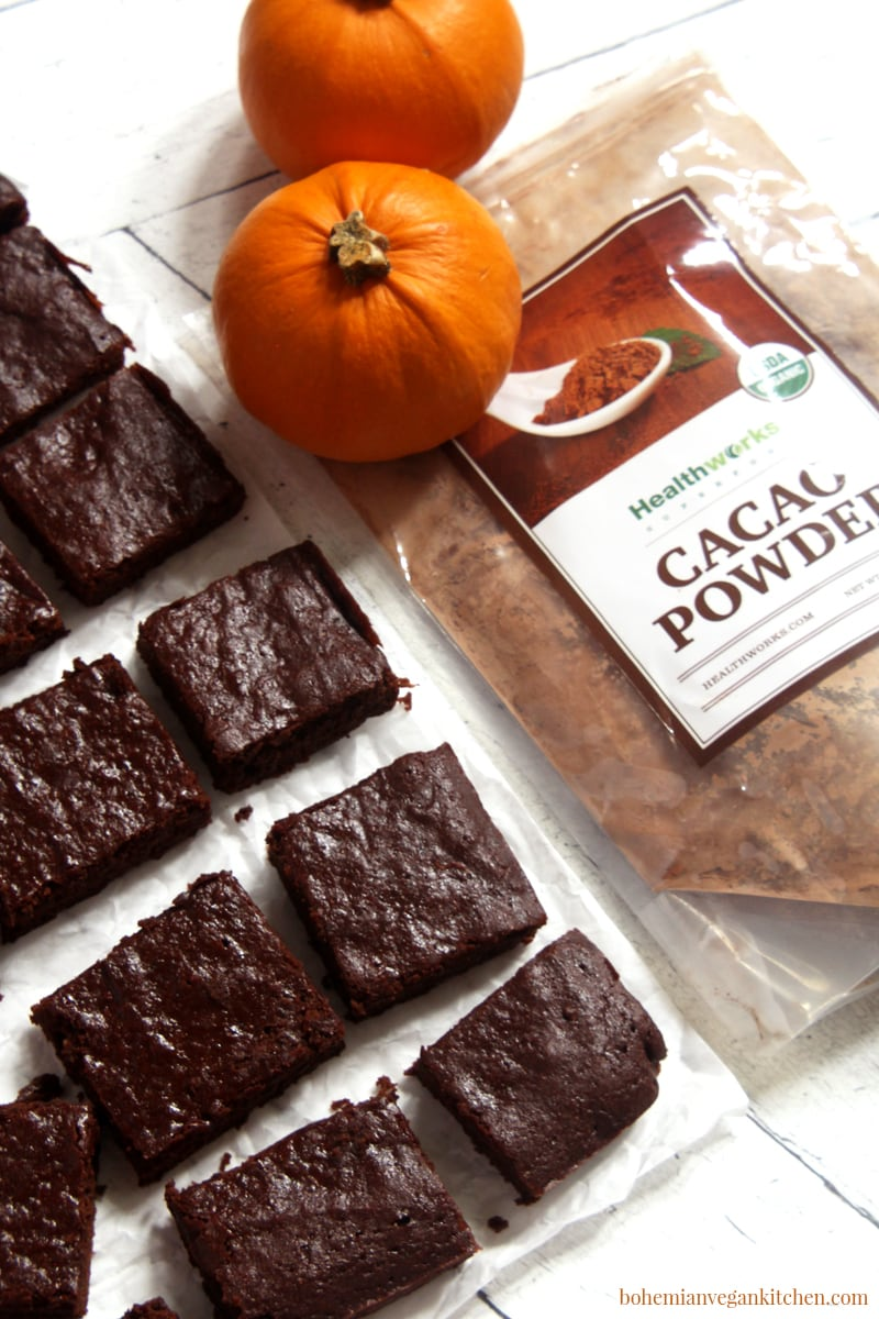 Reward yourself today with these fudgy, moist, and QUICK vegan pumpkin brownies! Taking only 10 min prep and 15 min to bake, these brownies are the MESSIAH of the conventional brownie, because they bring in the heavenly taste of pumpkin spice and rich cacao that is like an answer to all your brownie prayers. #veganpumpkinbrownies #veganpumpkinbrownieseasy #veganpumpkinbrownieshealthy #veganpumpkinrecipes #veganbrownieseasy #veganbrownies #bohemianvegankitchen