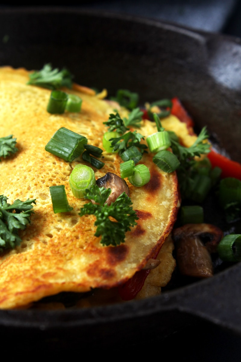 This one ingredient will take your vegan omelette to the next level, giving it real egg flavor without the eggs! Easy to make + naturally dairy-free, egg-free, and gluten-free, this omelette is the perfect way to start any morning. #veganomelette #veganomeletterecipe #veganbreakfast #veganbreakfasthealthy #veganbreakfastideas #veganeggrecipes #bohemianvegankitchen