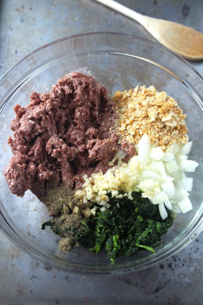 Picture of meatball ingredients in a medium bowl.