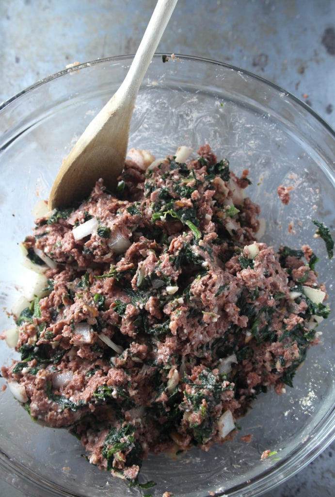 Picture of meatball ingredients mixed.