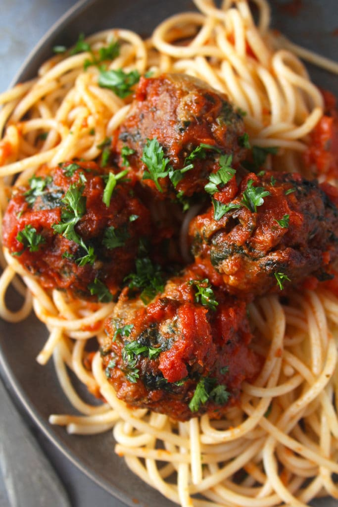 Close-up picture of meatballs on a plate.