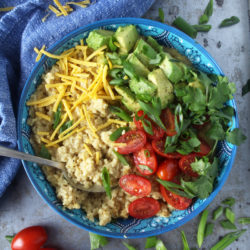 Who says oatmeal has to be sweet? I LOVE making this cheesy + savory vegan oatmeal, which takes less than 10 minutes to make! Topped with fresh tomatoes, diced avocado, cilantro, and green onions, this easy breakfast is the perfect way for your family to start the day. #veganbreakfastrecipes #veganbreakfasthealthy #veganbreakfastideas #quickveganbreakfast #veganoatmealrecipes #veganoatmealsavory #bohemianvegankitchen