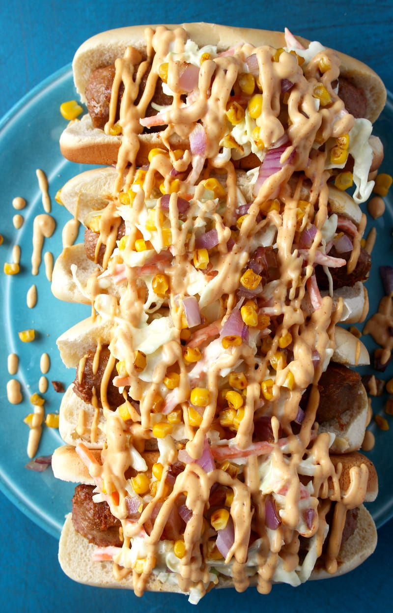 """Travel to the Magic Kingdom (while still in your PJ's) and enjoy this copycat Disney vegan hot dog, which is based on the slaw dog at Casey's Corner on Main, for half the price! Simple and delicious, this slaw dog will have you saying """"super cheers!"""" in no time. #veganhotdog #disneyveganfood #disneyveganrecipes #vegandisneyworld #beyondmeatrecipes #vegancomfortfood #bohemianvegankitchen"""