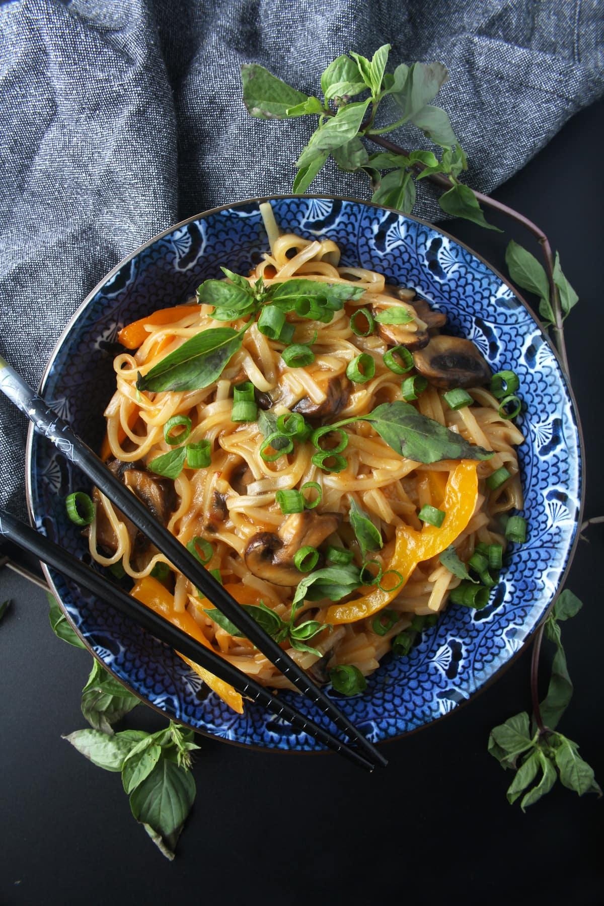 picture of chopsticks in a vegan drunken noodles bowl