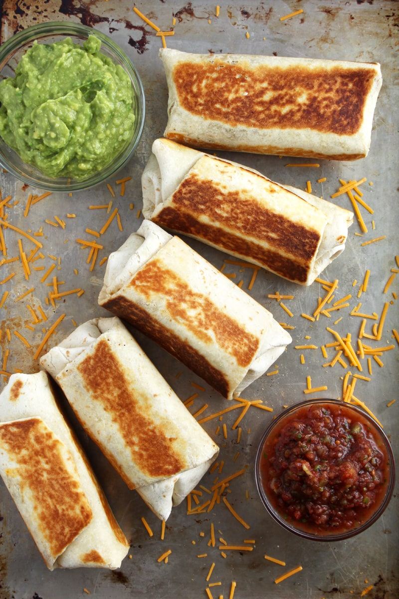 overhead picture of vegan chimichangas with salsa.