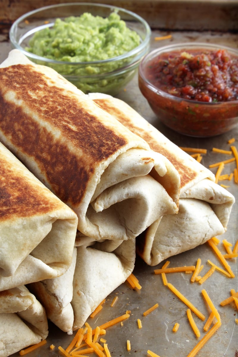 A side-view of chimichangas stacked.