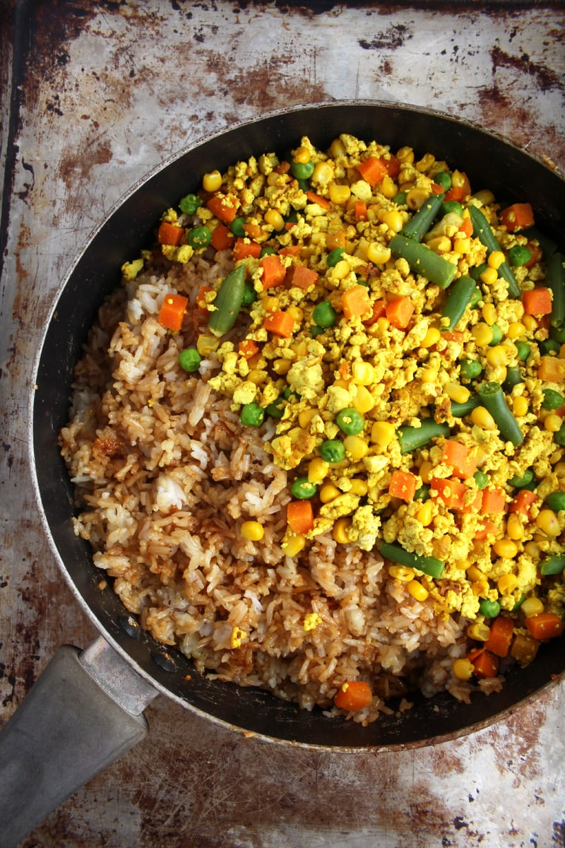 Picture of vegan fried rice in frying pan, before it's been mixed.