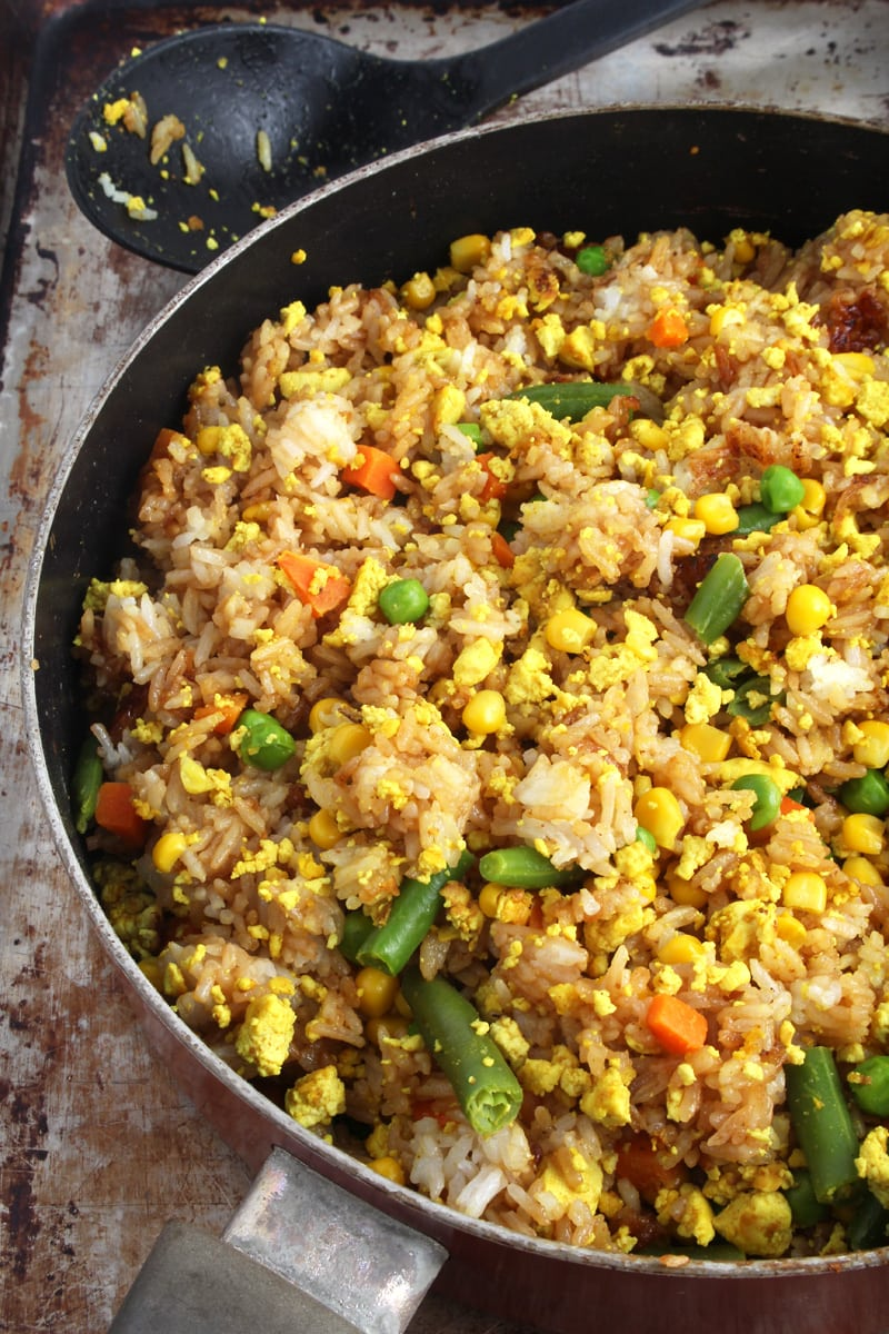 Picture of vegan fried rice being mixed together.