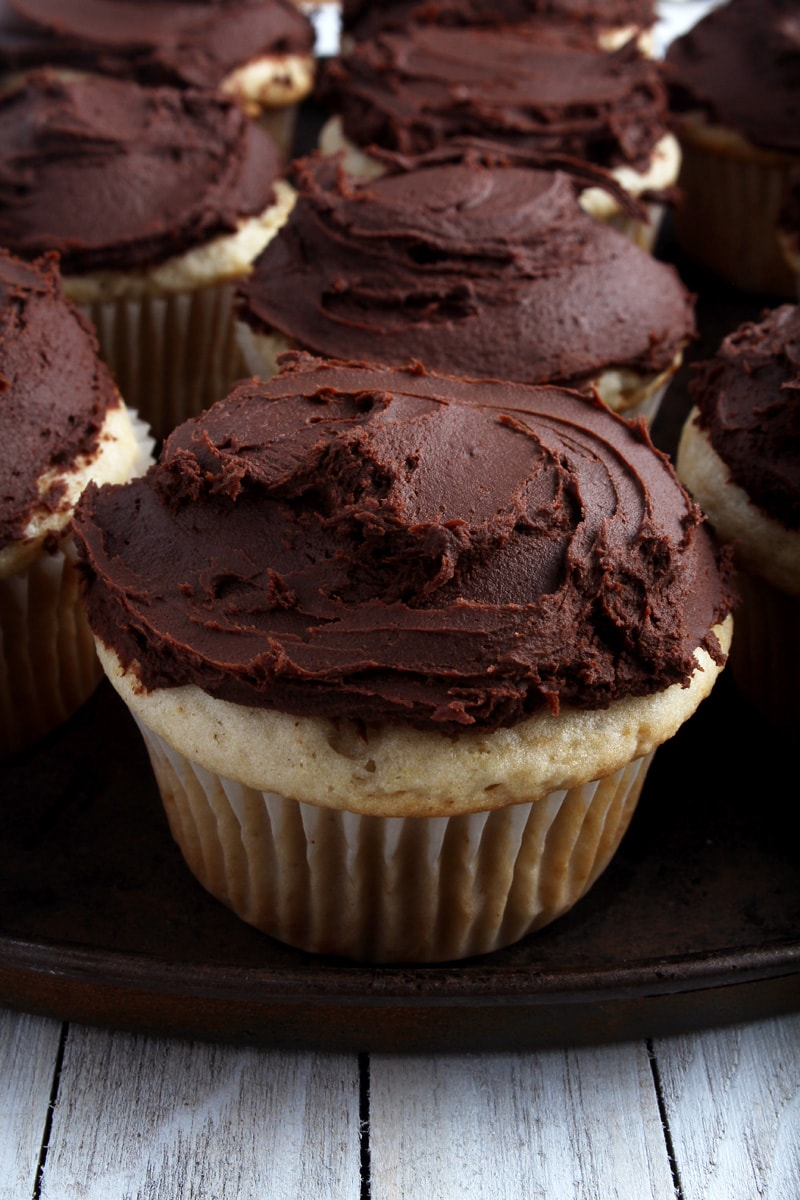 another picture of a vanilla cupcakes with dairy-free chocolate ganache frosting