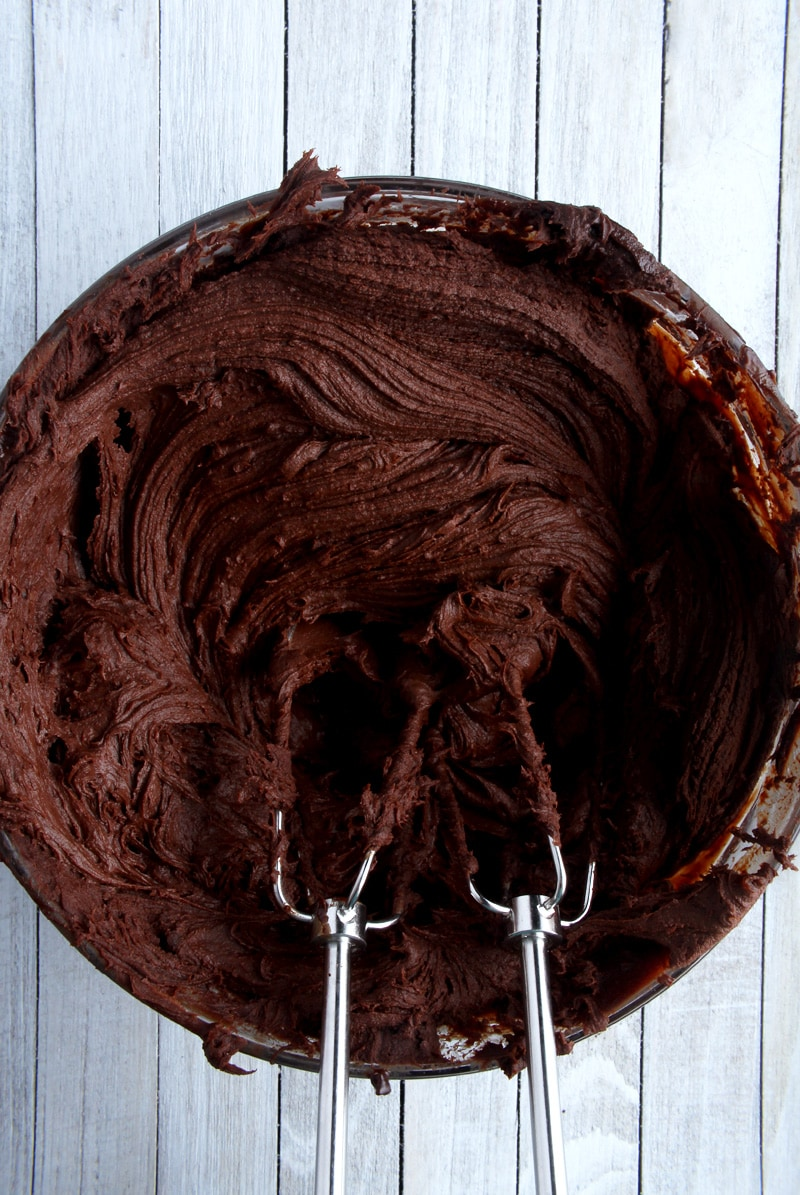 another shot of dairy-free chocolate ganache frosting in a bowl.