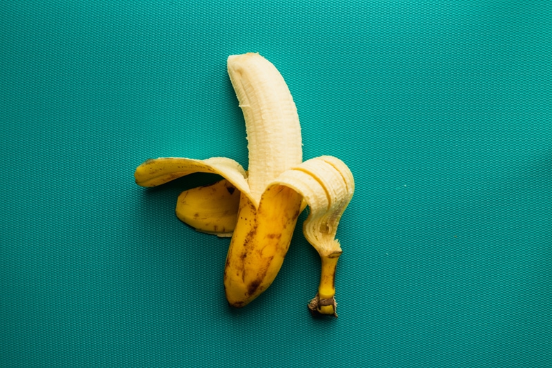 substitute eggs in baking: image of a peeled banana.