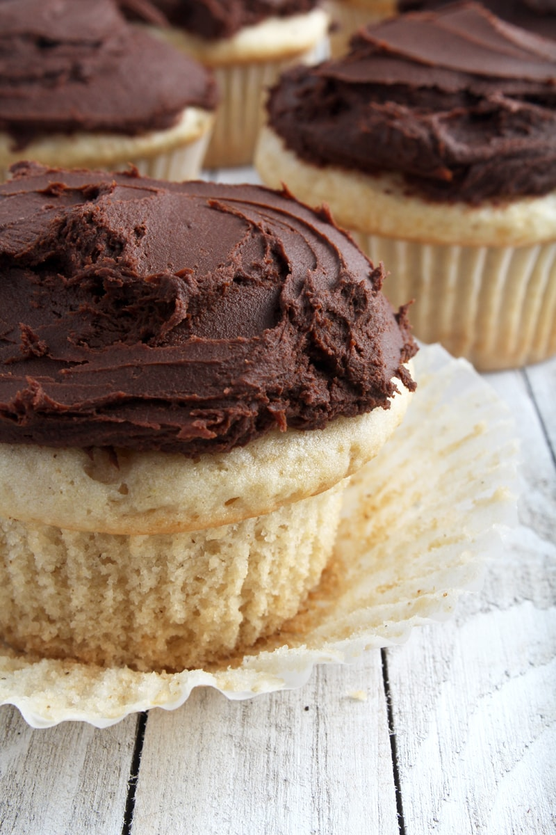 picture of beautifully frosted allergy free cupcakes with the wrapper peeled down.