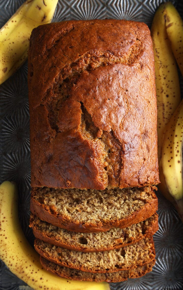 overhead shot of dairy free banana bread in an antique baking pan