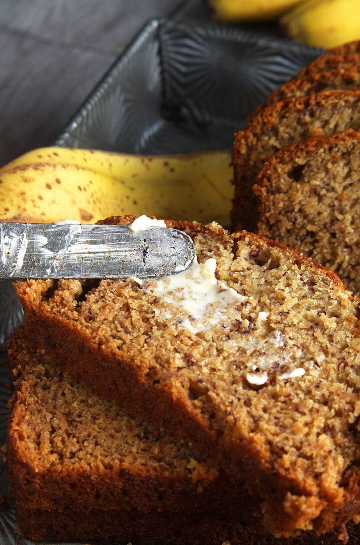 picture of vegan butter being spread on dairy free banana bread slice