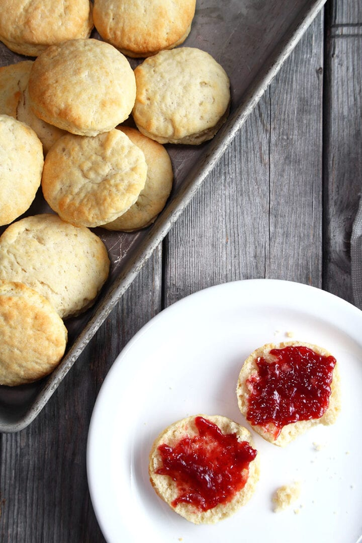 vegan biscuit split open with jam on top