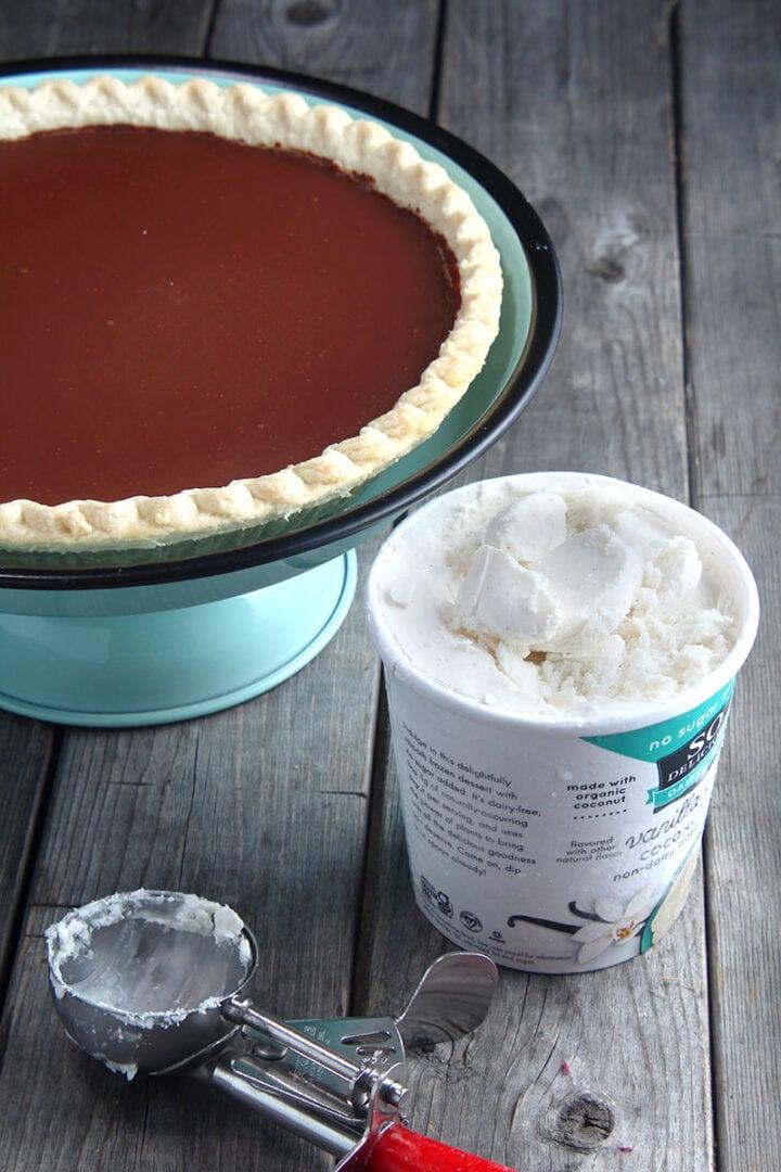 picture of vegan chocolate pie with vanilla ice cream and an ice cream scoop