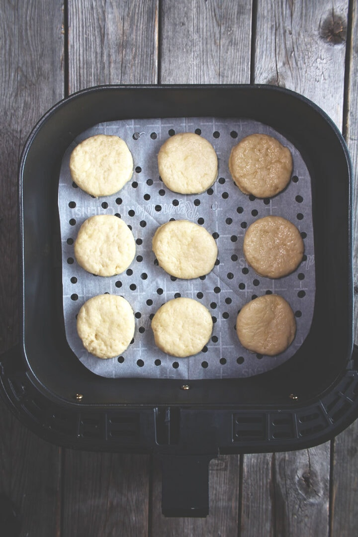picture of biscuit dough on parchment paper in the air fryer