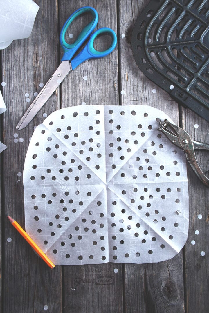 step four-- unfolding the parchment paper for air fryer