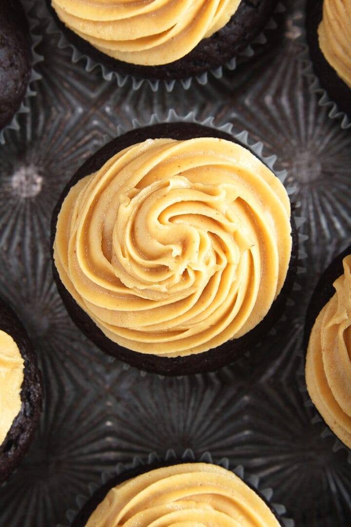 overhead shot of vegan peanut butter frosting on a chocolate cupcake