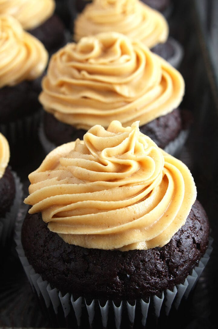 picture of vegan peanut butter frosting on top of a chocolate cupcake