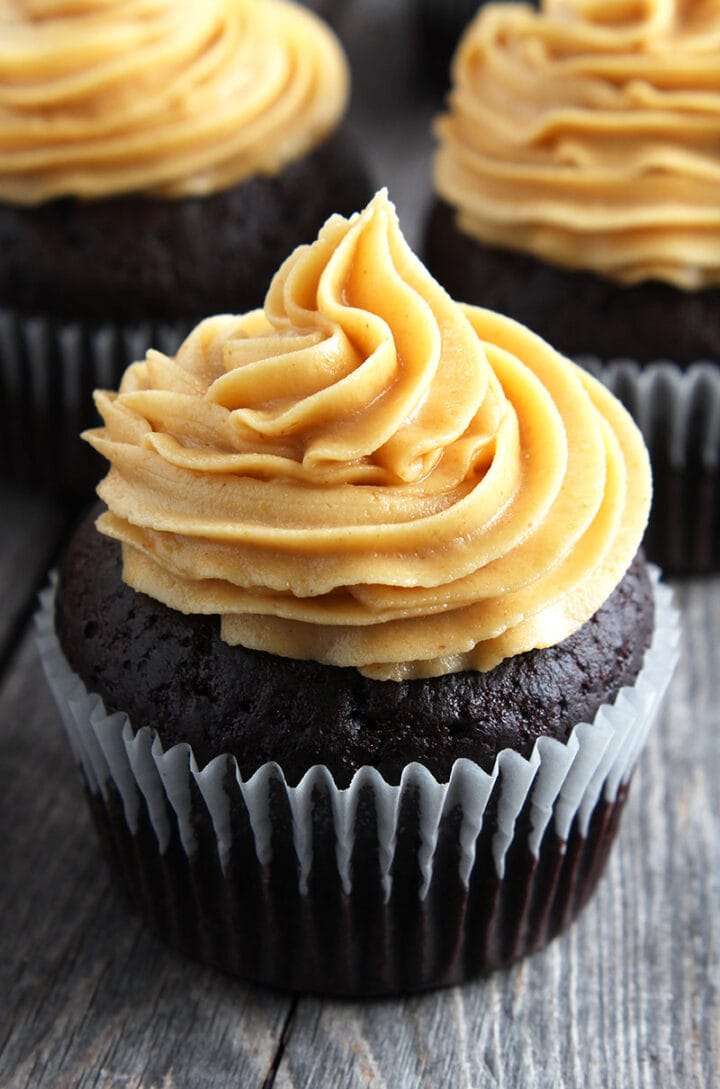 picture of vegan peanut butter frosting on a chocolate cupcake