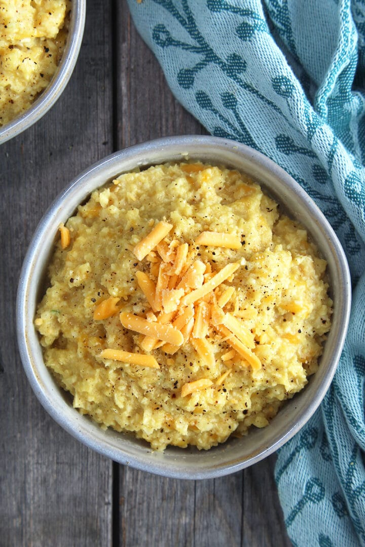 close up of cauliflower grits sprinkled with cheese