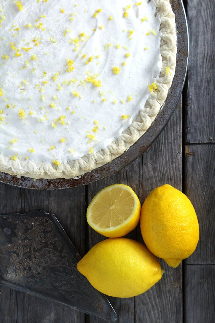 picture of the vegan lemon pie with whipped topping and lemon zest on top