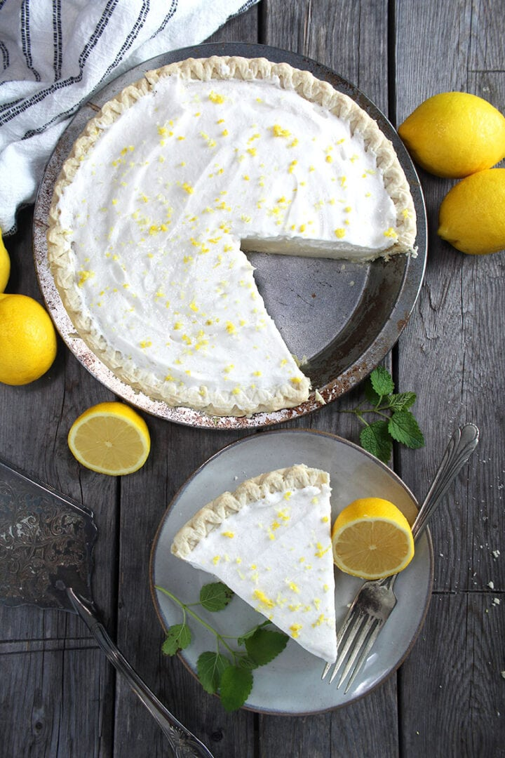 picture of the vegan lemon pie, with a piece cut out of it