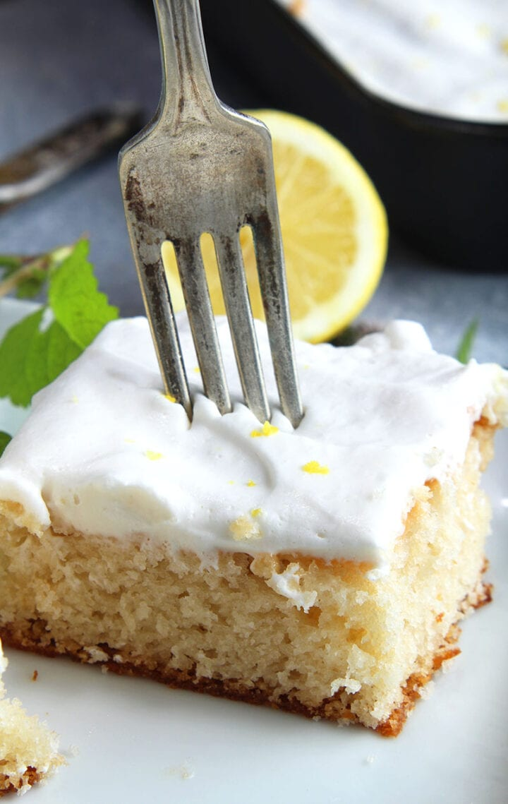 picture of a fork about to slice vegan lemon cake