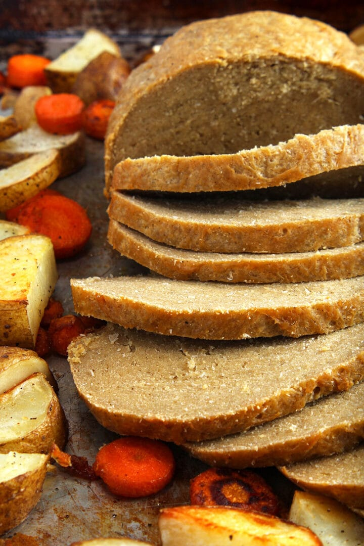 Picture of vegan turkey, sliced on a tray.