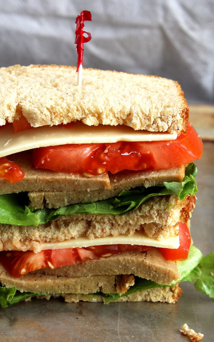 picture of vegan turkey slices stacked on a sandwich